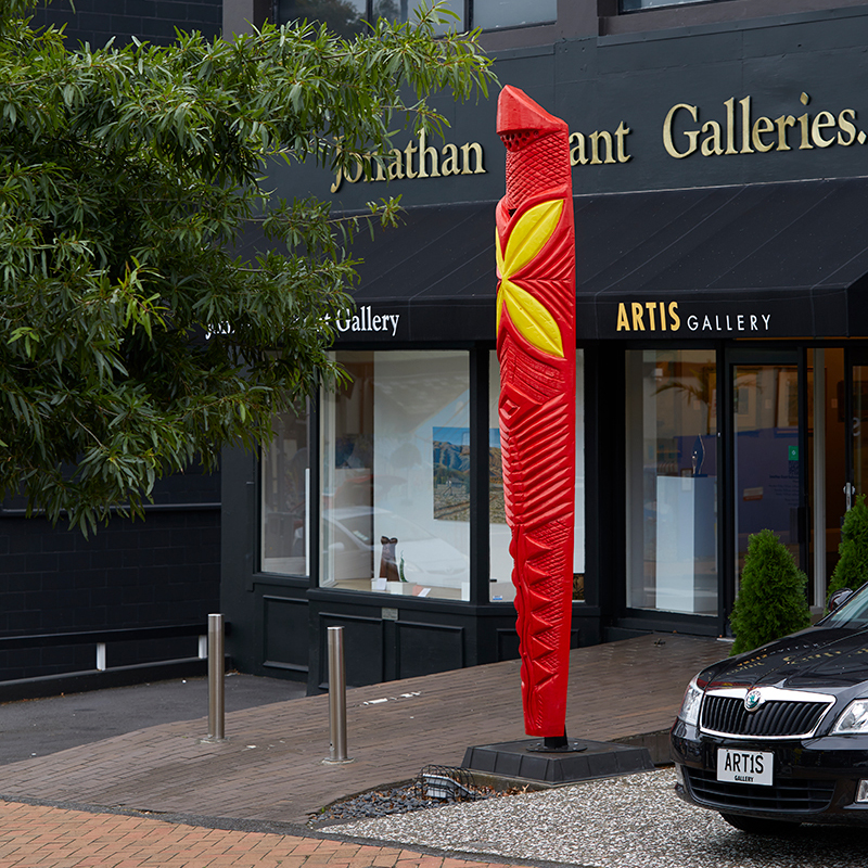 Road infant of art gallery with a large red sculpture and a landscape painting in the window